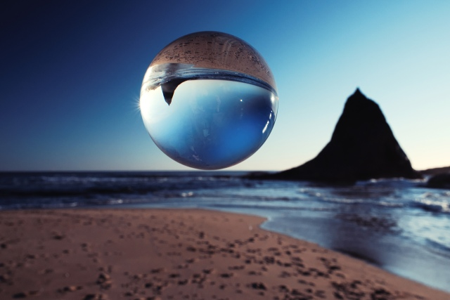 quartz sphere over beach